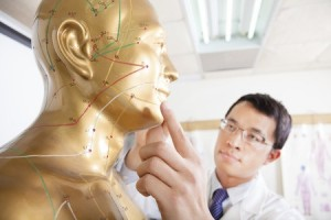 25791333 - chinese medicine doctor teaching acupoint on human model