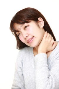 40327430 - young japanese woman suffers from neck ache