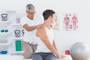 44766588 - doctor doing back adjustment in medical office
