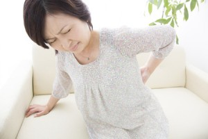 49304515 - middle women suffer from low back pain