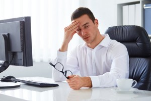 40285295 - young businessman under stress with headache and migraine